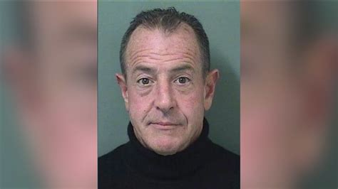 Michael Lohan surrenders to police to face battery charge